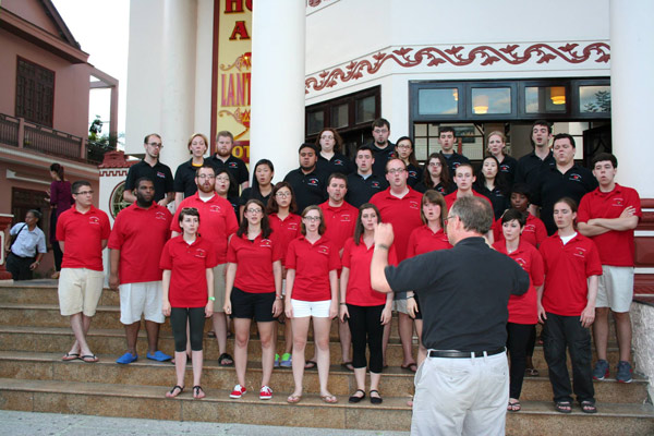 Kent Hatteberg and the University of Louisville Cardinal Singers performing on the streets of Hoi An in Vietnam.
