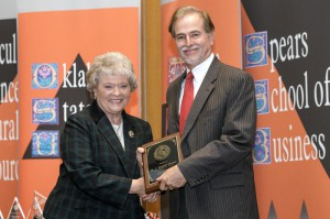 "OSU provost Pamela Fry presents Stroope with the 2013 Regents Distinguished Research Award for Oklahoma State University. This award recognizes ""exceptional research"" and ""creative activity."""