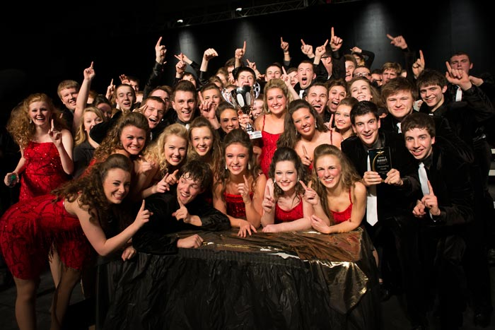 Visual Adrenaline posing with the Grand Championship from the Raise the Roof competition in Cedar Rapids, Iowa.